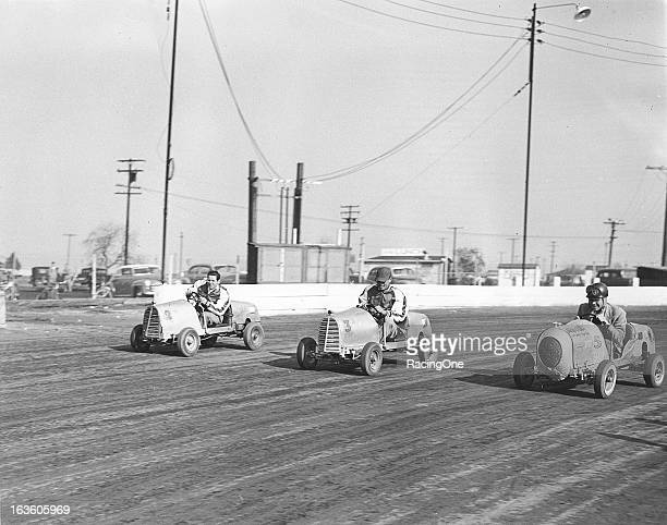 A trio of Micro Midget racecars battle on a dirt track in the late1940s The cars were a fun and economical way for just about anybody to go racing...