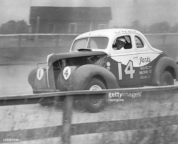 Bob Flock of Atlanta GA At the wheel of the Red Vogt Special Modified stock car that was owned by Raymond Parks Flock's brother Fonty Flock also...