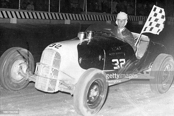 "Dick Frazier after taking a Track Roadster or ""Hot Rod"" win at Sun Valley Speedway"