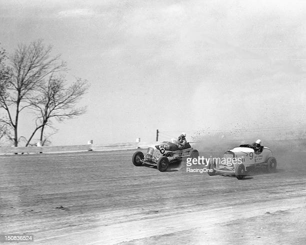 Drivers race a pair of Track Roadsters through a turn during a race in the late1940s These cars were incredibly fast but offered few safety features...