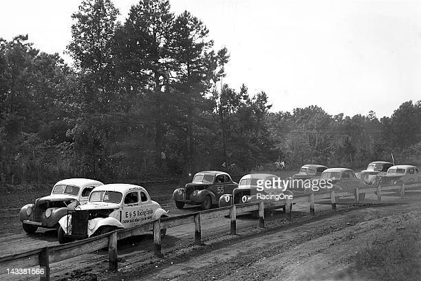 Fonty Flock has the pole position for this NASCAR Modified stock car race at Charlotte Speedway Flock's brother Bob Flock is behind the wheel of car...