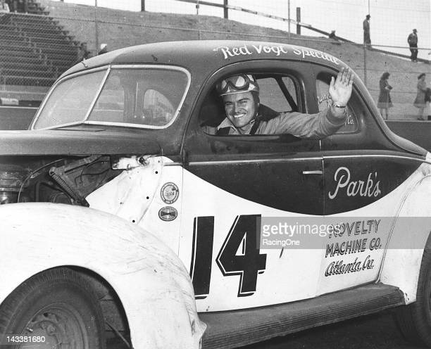 Fonty Flock waves from the seat of Raymond Parks' NASCAR modified stock car that was wrenched by Red Vogt Fonty's brother Bob Flock also drove the...