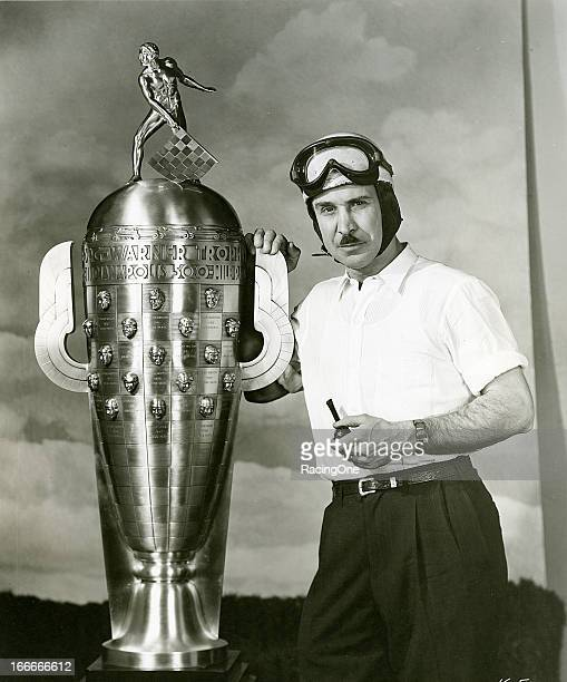 Late-1940s: Indy Car driver Mauri Rose of Columbus, OH, with the Borg-Warner Trophy, awarded each year to the winner of the Indianapolis 500 Indy Car...
