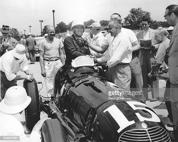 Lee Wallard of Schenectady NY is congratulated after winning a AAA Sprint car race in the late1940s Wallard went on to win the biggest race of his...