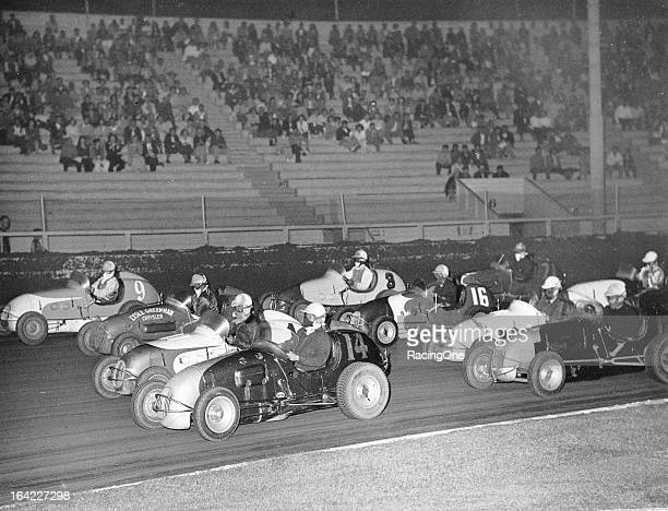"Midget racecars battle fourwide during a race at Gilmore Stadium The track hosted Midget racing from 1934 through 1950 and hosted the famed ""Turkey..."