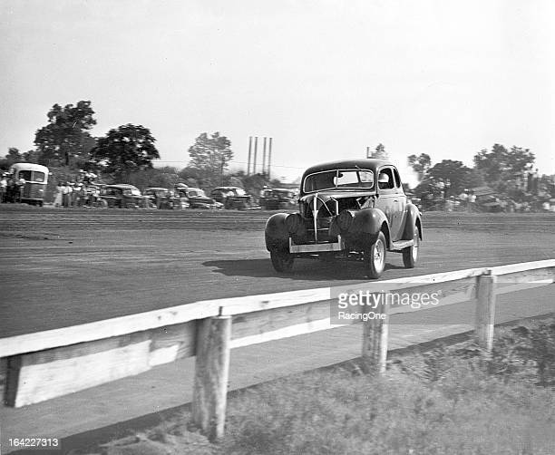 NASCAR star Jack Smith in action early in his career driving a Modified stock car on a dirt track Smith went on to become a star on the NASCAR Cup...