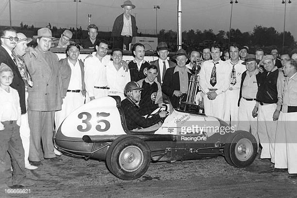 Ronney Householder attracts a crowd after winning a Midget car race at South Bend Motor Speedway Householder was the 1935 Detroit Coliseum champion...
