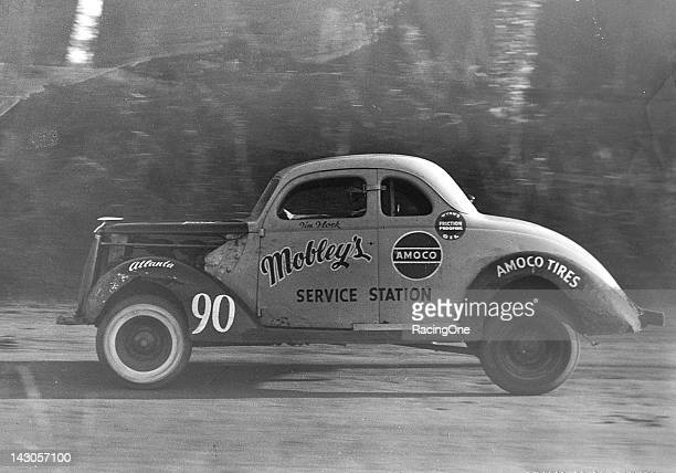Tim Flock hard at work in his NASCAR Modified stock car during a race in the late1940s