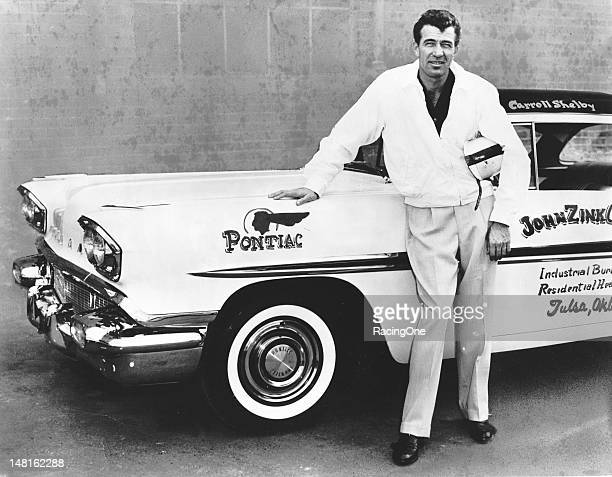 Carroll Shelby next to a 1958 Pontiac Chieftain, part of a new group of cars that the Pontiac Division of General Motors were promoting as their new...