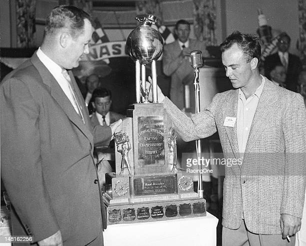 Driver Frankie Schneider of Lambertville NJ accepts the trophy honoring him as the 1952 NASCAR National Modified champion