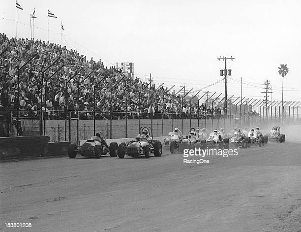 Late-1960s: A field of Sprint Cars takes the green flag for the start of a race at Plant Field. The International Motor Contest Association...