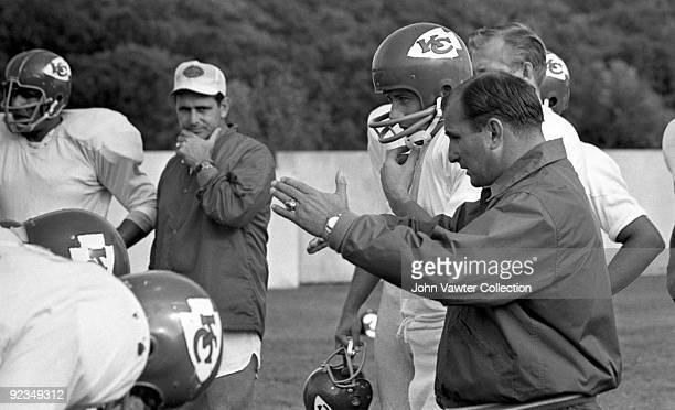 Quarterback Len Dawson and head coach Hank Stram of the Kansas City Chiefs participate in drills during training camp in the late1960s at William...