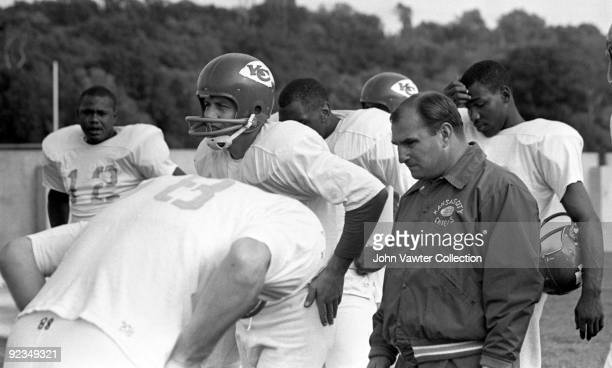 Quarterback Len Dawson and head coach Hank Stram of the Kansas City Chiefs watch drills during training camp in the late1960s at William Jewell...