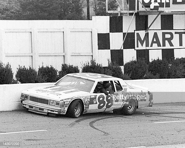 Darrell Waltrip waits for assistance after spinning into the wall during a NASCAR Cup race at Martinsville Speedway