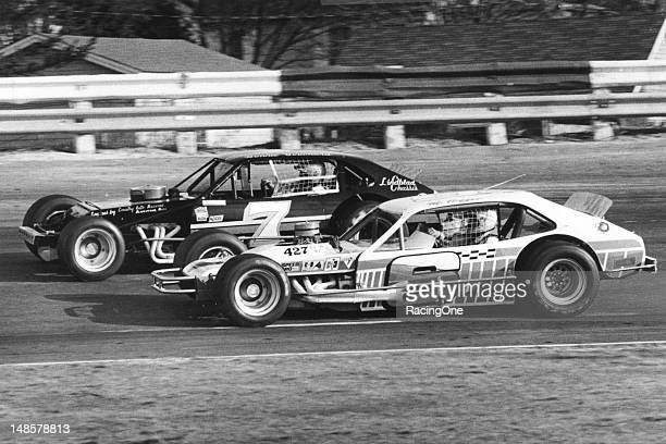 Maynard Troyer passes Ronnie Bouchard on his way to winning one of three consecutive Spring Sizzler NASCAR Modified races at Stafford Motor Speedway...