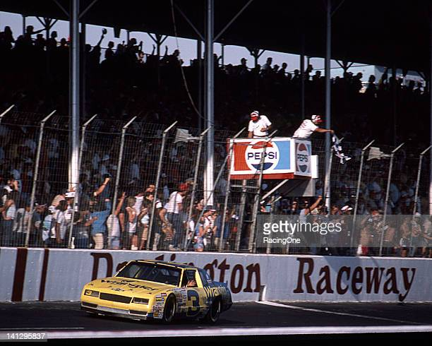 Dale Earnhardt takes the checkered flag to win a NASCAR Cup race at Darlington Raceway in Richard Childress' Wrangler Chevrolet In the four Cup races...