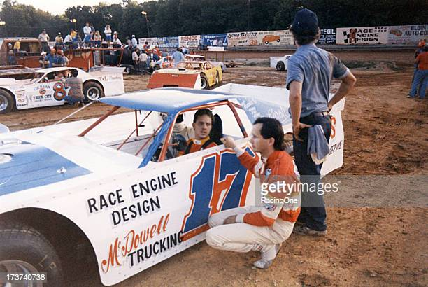Driver Dale McDowell talks with fellow driver Ronnie Johnson befor a NASCAR Winston Racing Series dirt track event