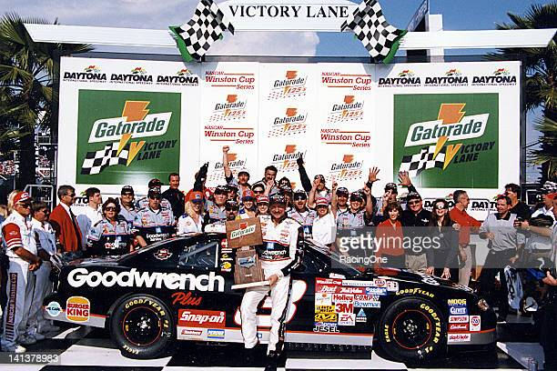 Dale Earnhardt and his crew celebrate in victory lane at Daytona International Speedway after a win in one of the Gatorade 125 qualifying races for...