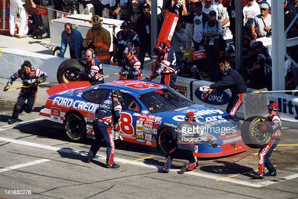 Dale Jarrett pits the Yates Racing Ford Taurus during a NASCAR Cup race