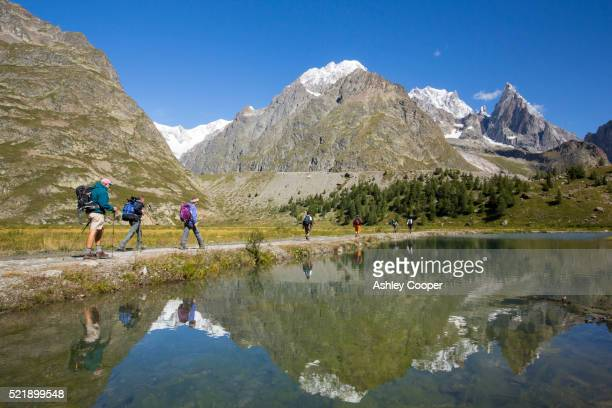 lateral moraine on the side of the rapidly retreating glacier de miage below mont blanc, italy - vista lateral stock pictures, royalty-free photos & images