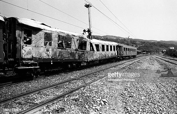 Lateral sight of the passenger car of the Italicus Express, running from Rome to Munich that has been gutted by an explosion on the Bologna-Florence...