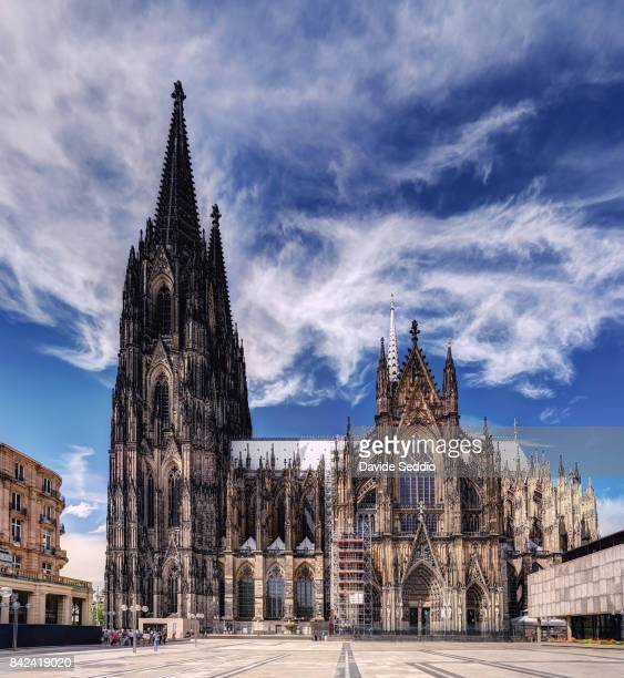 lateral view of the cologne cathedral - cologne cathedral stock photos and pictures