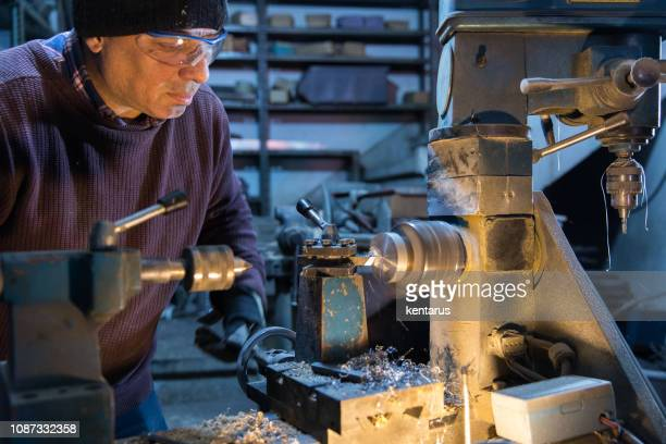 Lathe technician while working on part - Milling machine operator