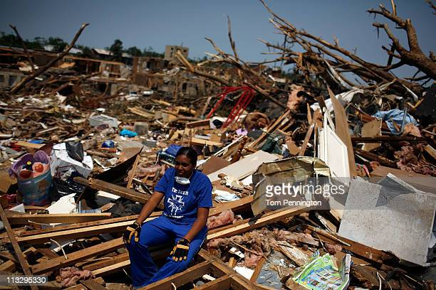 LaTia Cobbs sits amid the rubble of her destroyed home on April 30, 2011 in Tuscaloosa, Alabama. Cobbs and her four children were buried under the...