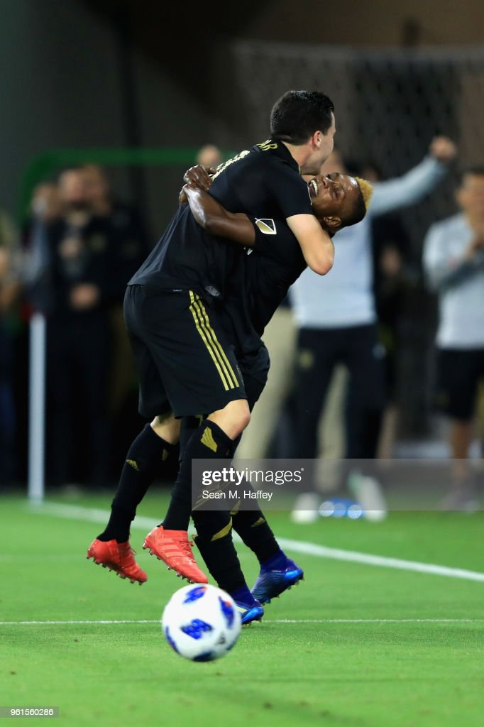 Latif Blessing #7 congratulates Aaron Kovar #11 of Los Angeles FC on his goal during the second half of an International friendly soccer match against the Borussia Dortmund at Banc of California Stadium on May 22, 2018 in Los Angeles, California.