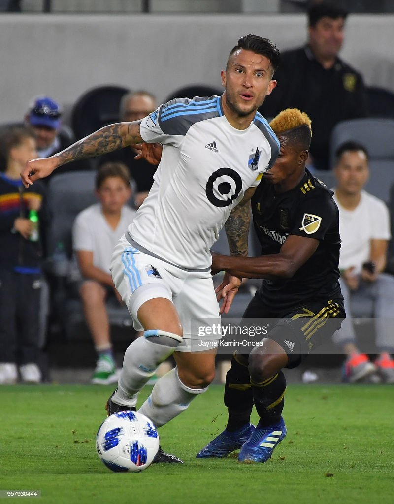 Latif Blessing #7 of Los Angeles FC and Francisco Calvo #5 of Minnesota United battle for the ball in the game at Banc of California Stadium on May 9, 2018 in Los Angeles, California.