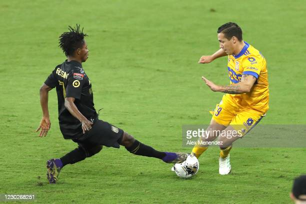 Latif Blessing of Los Angeles FC and Jesus Duenas of Tigres UANL fight for the ball during the CONCACAF Champions League final game at Exploria...