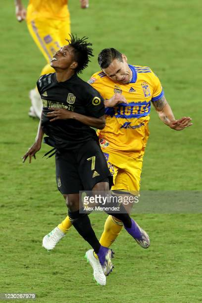 Latif Blessing of Los Angeles FC and Jesus Duenas of Tigres UANL crash into each other while attempting to head the ball during the CONCACAF...