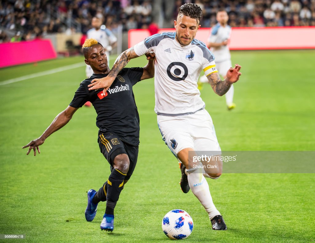 Latif Blessing #7 of Los Angeles FC battles Francisco Calvo #5 of Minnesota United during Los Angeles FC's MLS match against Minnesota United at the Banc of California Stadium on May 9, 2018 in Los Angeles, California. Los Angeles FC won the match 2-0