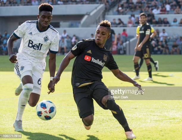 Latif Blessing of Los Angeles FC chases the ball as Alphonso Davies of Vancouver Whitecaps defends during Los Angeles FC's MLS match against...