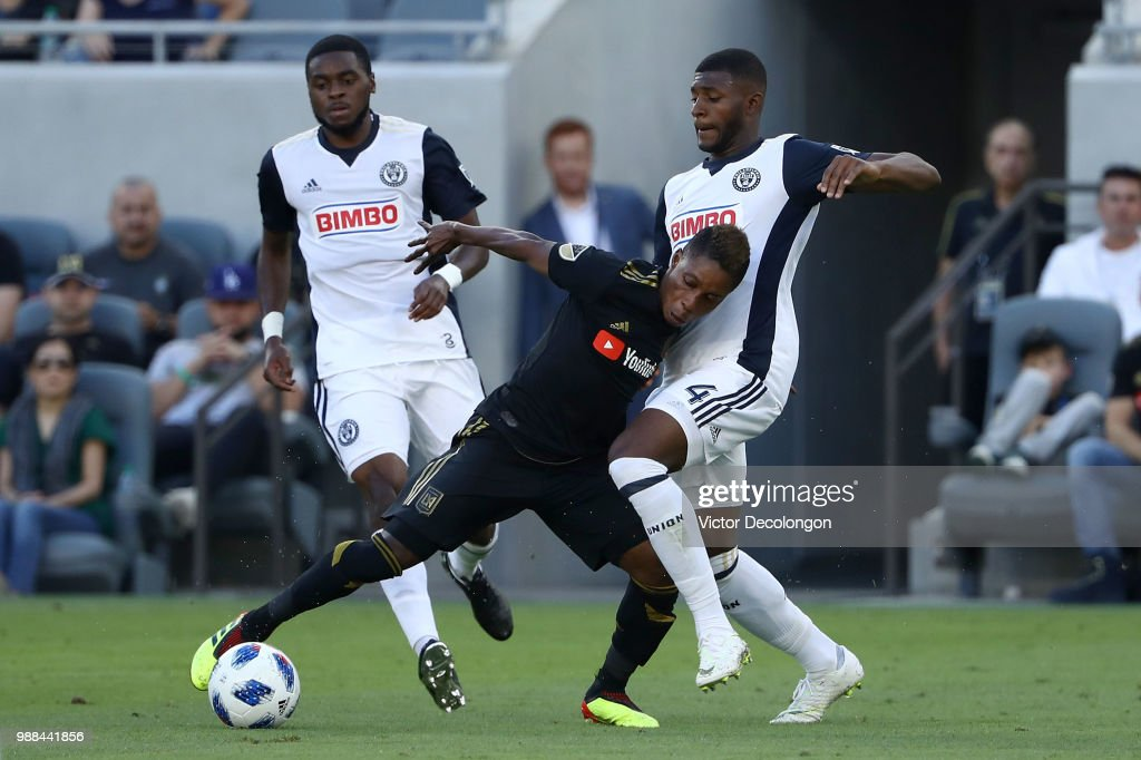 Latif Blessing #7 of Los Angeles FC holds off a challenge by Mark McKenzie #4 of Philadelphia Union as Marcus Epps #20 of Philadelphia Union looks on during the second half of their MLS match at Banc of California Stadium on June 30, 2018 in Los Angeles, California. Los Angeles FC defeated the Philadelphia Union 4-1.