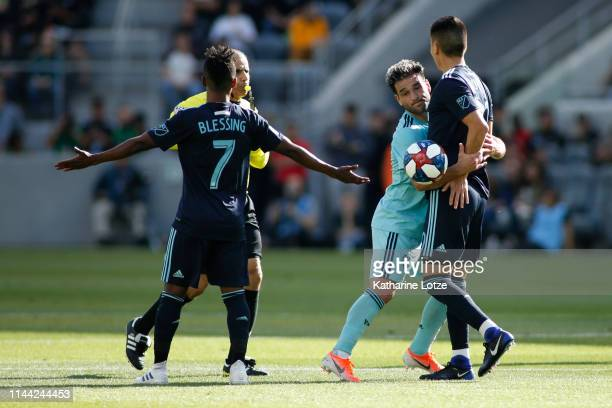 Latif Blessing of Los Angeles FC protests to the official as Nicolas Lodeiro of Seattle Sounders grabs Eduard Atuesta of Los Angeles FC during a game...