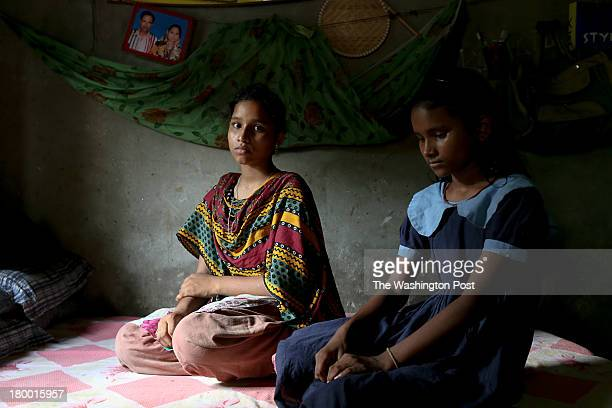 Latifa and Arifa, the daughters of a garment worker who died at Rana Plaza, at home on July 30, 2013. Latifa is now considering garment work to...