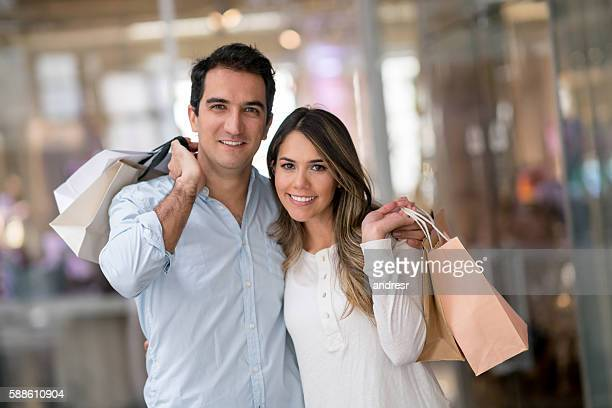 Latin American couple shopping at the mall