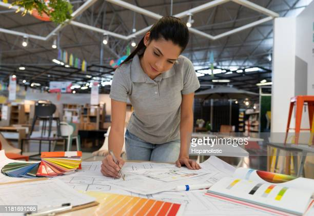 latin american designer working at a furniture home store on different designs - interior designer stock pictures, royalty-free photos & images