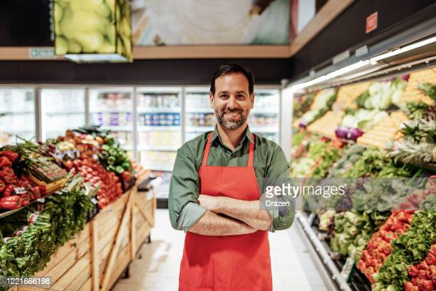latin american employee - portrait of handsome essential worker in night shift - essential services stock pictures, royalty-free photos & images