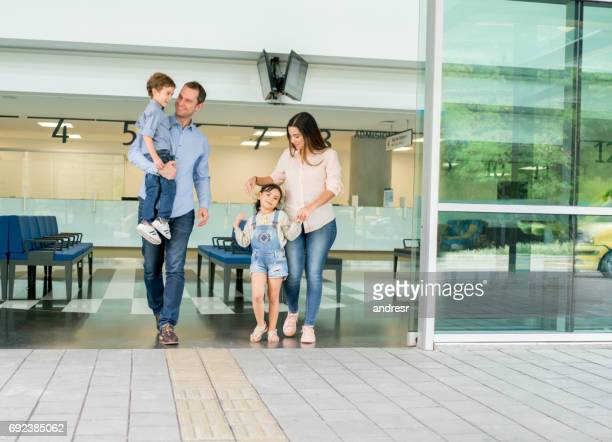 Latin American family leaving at the hospital