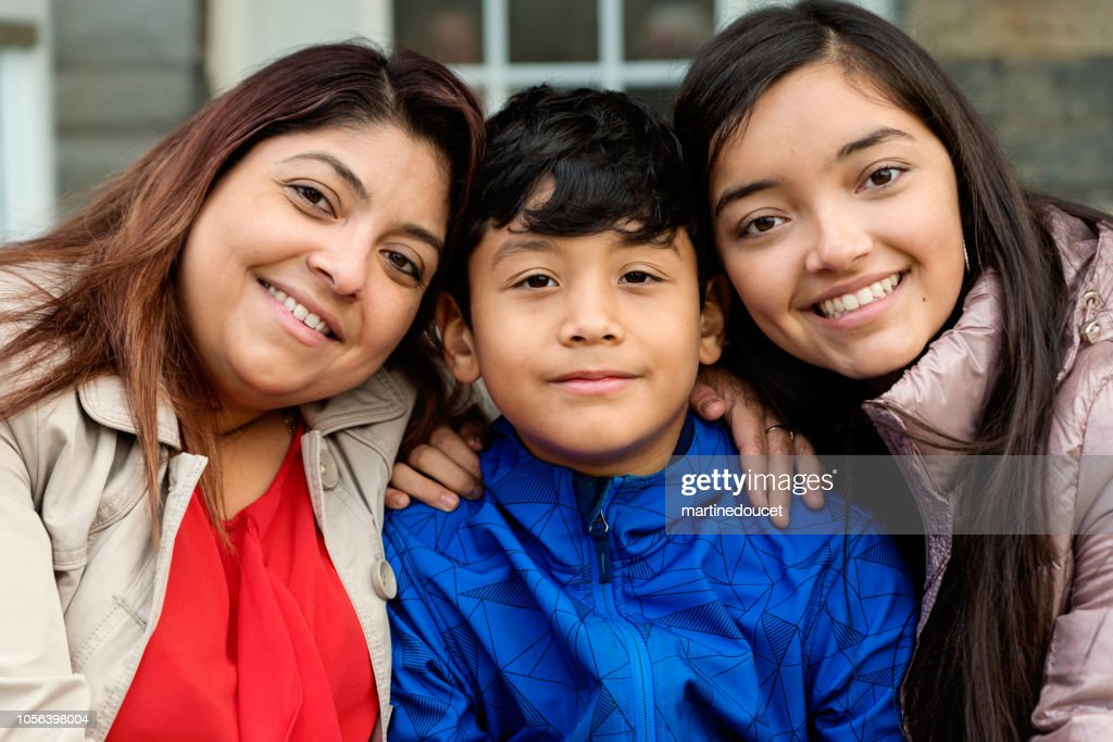 Latin American family portrait outdoors. : Stock Photo