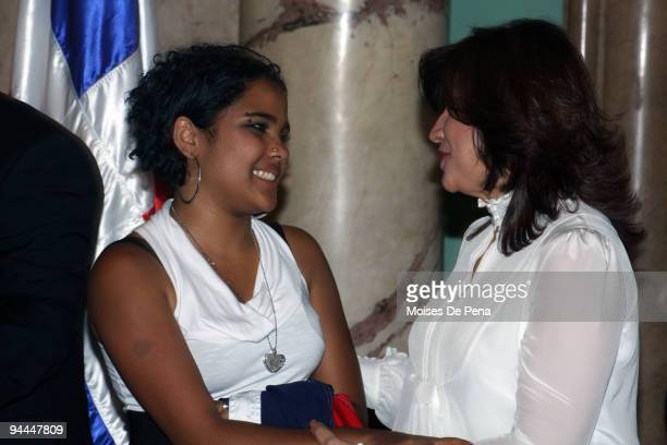 Latin American Idol Martha Heredia and First Lady Margarita Cedeno Fernandez speak during Latin American Idol's arrival to the Presidential Palace on...