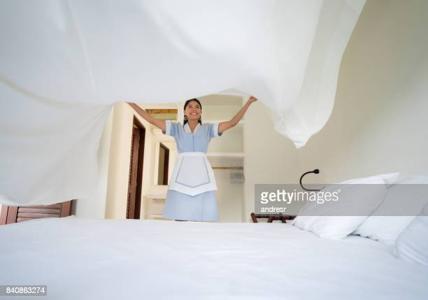 latin american maid working at a hotel - hotel stock pictures, royalty-free photos & images