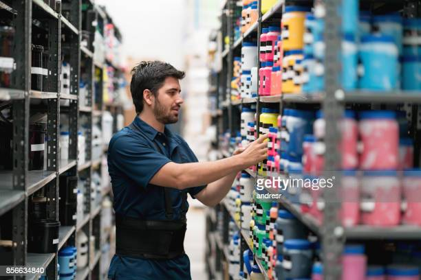 latin american man working at a warehouse - chemical stock pictures, royalty-free photos & images