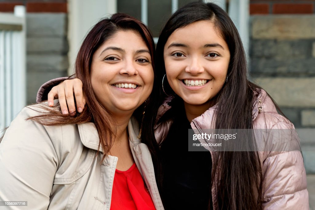 Latin American mother and teenage daughter portrait outdoors. : Stock Photo