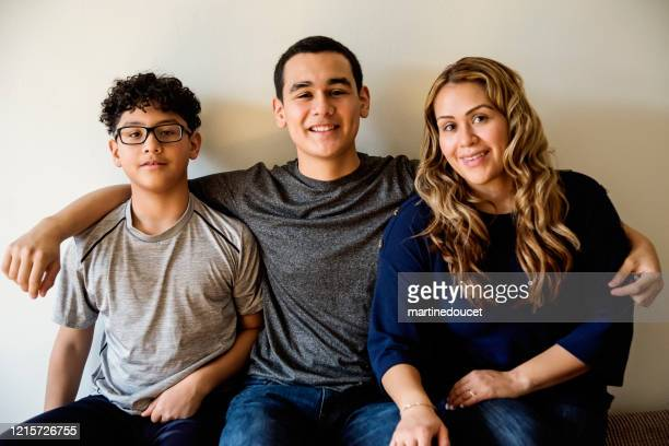 """latin american mother with teenage boys family portrait. - """"martine doucet"""" or martinedoucet stock pictures, royalty-free photos & images"""