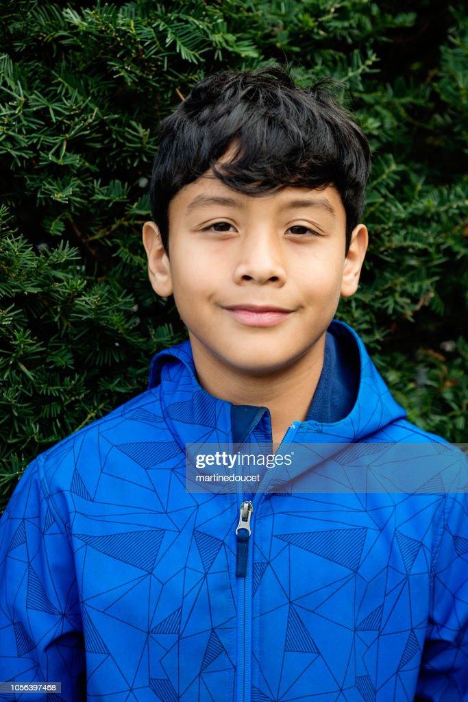 Latin American preteen boy portrait outdoors. : Stock Photo