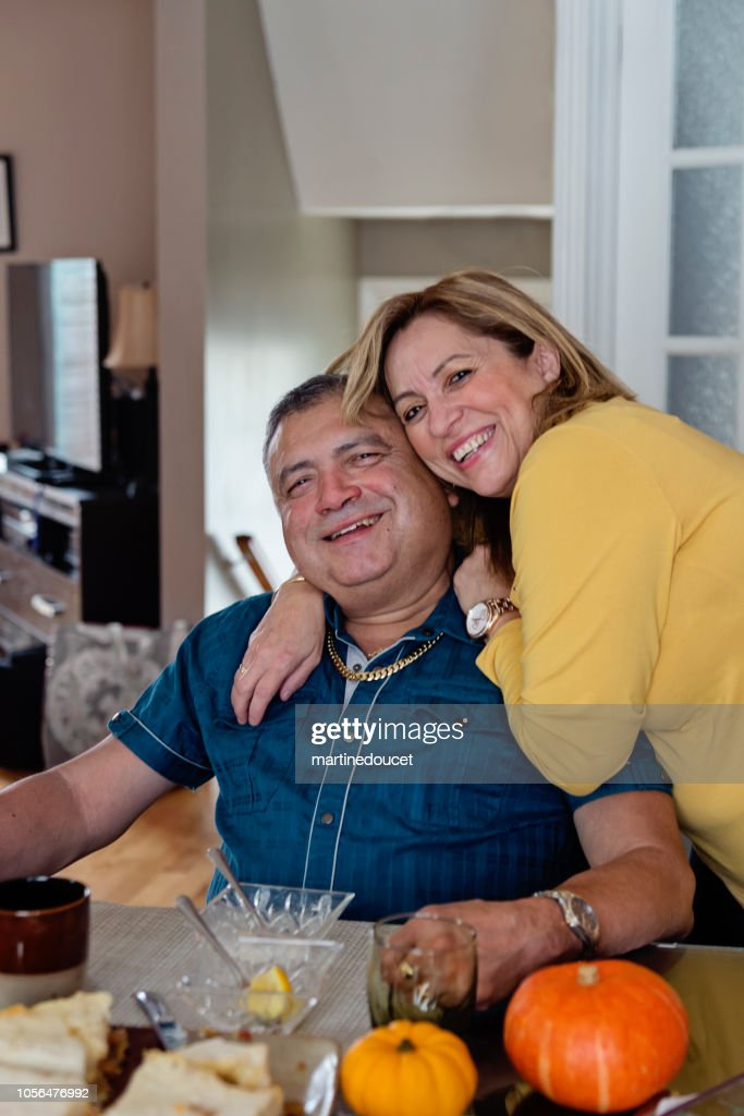 Latin American senior couple portrait at meal time. : Stock Photo