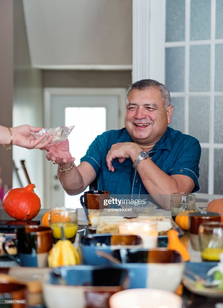 Latin American senior man sitting at the family table. : Stock Photo
